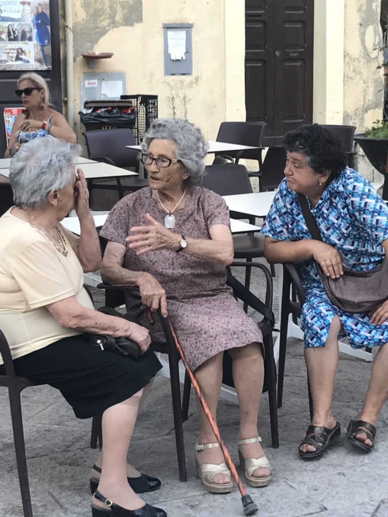 If you want people to tell you the truth, you need to listen well and you need their trust. Like these lifelong friends in an Italian Piazza.